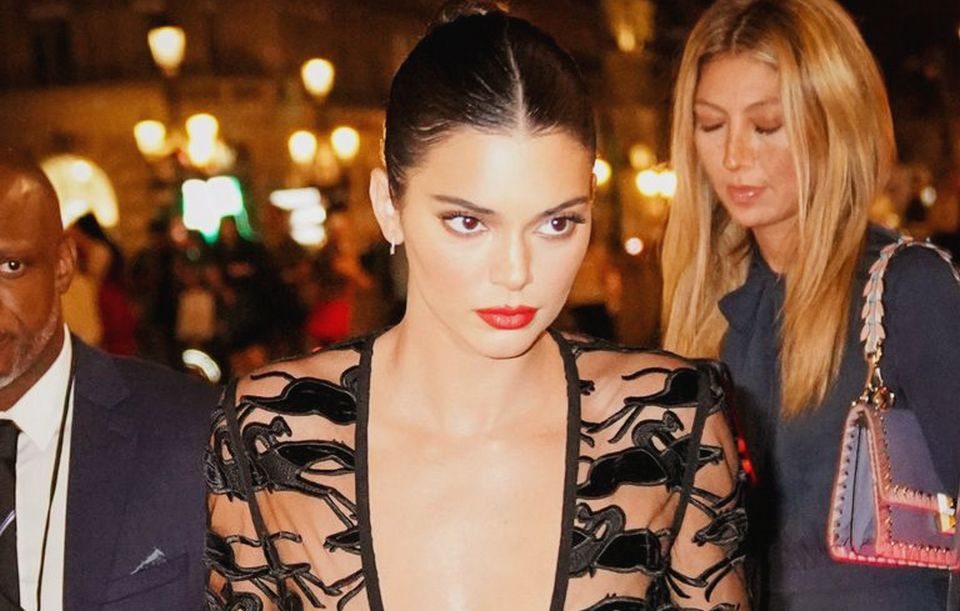 Kendall Jenner looked stunning in a black sheer dress in Paris when she arrived to attend the Longchamp 70th anniversary party at Opera Garnier in France.